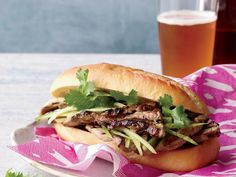 Grilled-Pork Banh Mi: After marinating in a sweet-and-spicy marinade, the pork gets grilled on skewers and served in a baguette Vietnamese-style, with cucumber and cilantro. Pork Recipes, Wine Recipes, Great Recipes, Cooking Recipes, Cooking Ribs, Favorite Recipes, Summer Recipes, Asian Cooking, Grilling Recipes