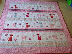 Great quilt idea for my pet-loving friends. Love the adorable cats.  Made by Jackie Walker Jarvis for a local Humane Society auction.  found on 24blocks.com