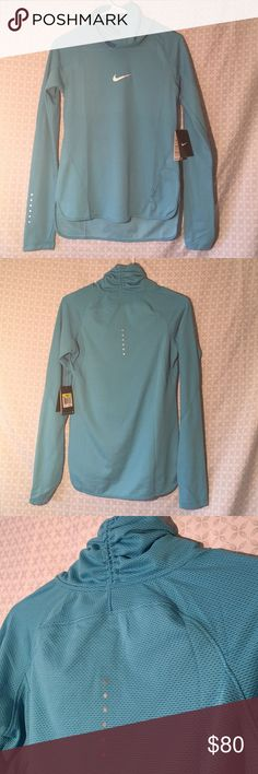 Women's Nike Running Long Sleeve Long sleeve turtle neck style dri-fit running shirt by Nike baby blue color. Brand new with tags! Nike Tops Tees - Long Sleeve
