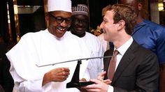 Nigeria's President Muhammadu Buhari receiving a gift from Mark Zuckerberg in…