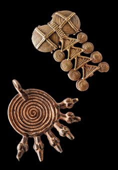 Africa | Two pendants; left/bottom from the Lobi people of Burkina Faso and right/top from the Tusia people of the Ivory Coast | Brass | Est. 530 - 800€ for the set