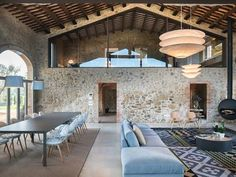Photo 3 of 14 in Farmhouse In Girona, Spain. Browse inspirational photos of modern homes. From midcentury modern to prefab housing and renovations, these stylish spaces suit every taste. Autocad Architecture, Interior Architecture, Interior And Exterior, Interior Design, Room Interior, Hanging Fireplace, Limestone Flooring, Farmhouse Renovation, Barn Renovation