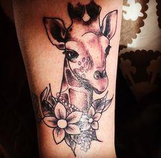 Custom Giraffe Tattoo from Beneath The Surface Tattoo and Piercing, Cumbernauld. #giraffetattoo #giraffe #flowers