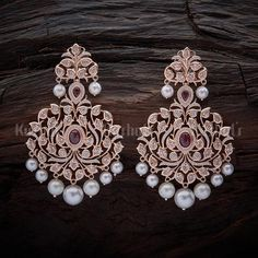 Designer zircon earrings studded with ruby and stones, with pearl hangings and plated with gold polish and made of copper alloy Indian Jewelry Earrings, Jewelry Design Earrings, Gold Earrings Designs, Ear Jewelry, Bridal Earrings, Bridal Jewelry, Silver Necklaces, Silver Earrings, Silver Jewelry