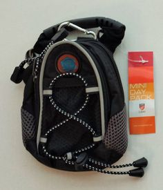 Christian Theme BLACK MINI BACK PACK $ 18.00  ITEM #: LGD2822 - BLACK  The Mini Pack is an outstanding carry-all solution for everyone. Use it while on a walk or run, walking the dog, and running. Great for carrying your phone, wallet, keys and other items.  Constructed of durable nylon Comes with belt loop, rubber handle, metal clip and detachable shoulder strap Spec's: 5x7x3.5 Weight: 6oz Comes with the Love The Lord Logo Vendor: CMC Golf Inc