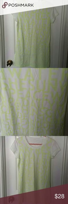 Lululemon top Brand new, size tag is off but most of my tops are in size 8. White cap sleeves with lime green inspirational print all over lululemon athletica Tops Tees - Short Sleeve