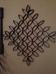 Made 2 of these from toliet paper rolls, added gems to give it some color. still hanging on wall a year later. Love them