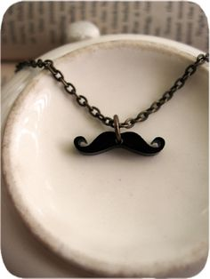 The Tiniest Mustache Necklace Ever - $12 @Lindsey Ellis you should buy this and hold up the stache when you're around Matt and his friends hahaha