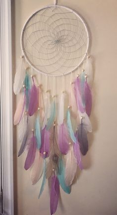 A personal favorite from my Etsy shop https://www.etsy.com/listing/525547904/unicorn-dreamcatcher-mermaid-large-dream