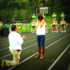 My fiance is the Head Athletic Trainer at AC Reynolds Highschool. He proposed before the Friday night football game!  The cheerleaders signs said Will You Marry Me? I said YES!