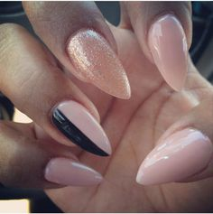 Nude and black pointy nails. Stilettos.