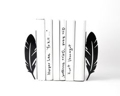 Feathers bookends laser cut out of metal. Strong enough to hold any bunch of books on your shelf.   Powder coated laser cut metal. One piece measures 7.1 by 2.7 with base measuring 3.6 wide in (18 cm by 7 by 9 cm deep). Sold by a pair only.