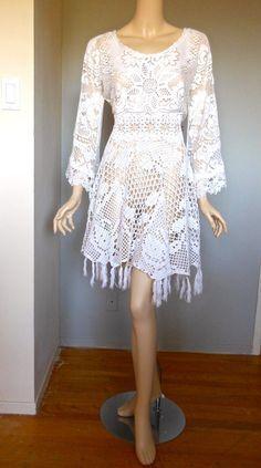 Looks like a hand-made dress...it so beautiful and angelic.