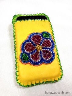 Tanned leather hand beaded cell phone case.