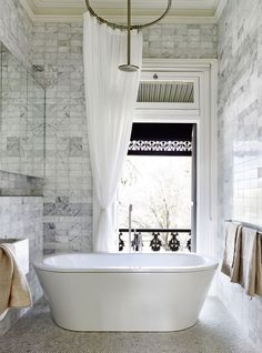 stunning master bath with marble tile | house tour on coco kelley