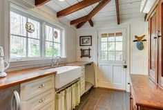 Country Kitchen with Exposed beam by Mary Hayes | Zillow Digs  | Zillow