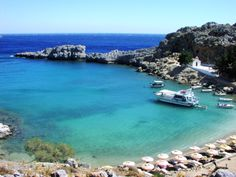 Rocky beach cove on the island of Rhodes in the Aegean Sea, Greece Greece Vacation, Greece Travel, Vacation Spots, Athens Beach, Athens Greece, Rhodes Beaches, Travel Competitions, Greece Wallpaper, Beach Cove