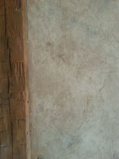 Close up of rustic finish in great room at Sylvania, OH home . These finishes have  numerous subtle colors and tones, not to mention texture! Finish by Kim Seidel
