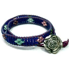 "This new piece from me has rich shades of cobalt blue, burgundy, pinks and greens.  A double wrap leather beaded bracelet inspired by nature.  I have called this ""Twilight Gardens"".  Imagine a soft su"