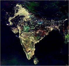 Population/economic growth in India via night lights.  The white lights were the only illumination visible before 1992; the blue lights appeared in 1992; the green lights in 1998; and the red lights in 2003.