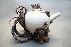 Image: by Mary O'Malley. Bottom Feeders Collection. Porcelain Teapot. We love to have picnics by the sea. Our appetites seem more inspired when we are near the ocean. We found some exceptionally beautiful tableware and vessels to make dining in the salty air an even more beautiful experience.  #BeautifulNow! #ceramics #teapots #creation #porcelain #ocean