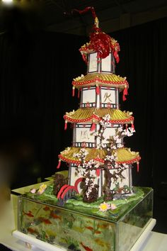 Garden wedding cake Japanese pagoda with koi fish accents in sugar pond.  Must have been expensive- Worth every penny!