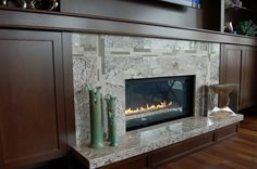 Bianco Antico granite fireplace with mosaic tile inset. Extend floating hearth off to the right.