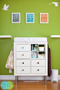 CREATE A CHANGING TABLE USING IKEA AND SOME EXTRAS :) GET 1 IKEA Expedit storage unit — with drawer inserts, sold separately — and bought legs (they're in the kitchen department) to make it a little higher. I found cute knobs at Anthropologie for a more sophisticated look. The two shelves on either side are also from IKEA.