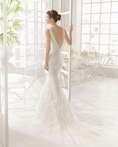 MADRID vestido de novia  en pedreria y plumas.