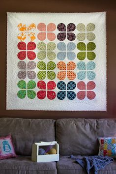 I totally dig this! I think it would be fun to do one flower per column, staggered with similar shaped leaves going up to them from the bottom. Maybe someday I'll try that. If you beat me to it, let me know! :) Retro Flowers Quilt by The Sometimes Crafter. $10