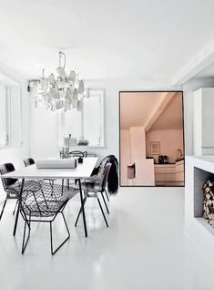 Love how the copper toned mirror brings this black/white dining area to life! via fashionsquad.com
