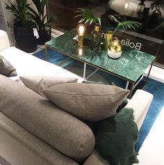 Love this light grey sofa and green marble table in the window of the new BoliaLove this light grey sofa and green marble table in the window of the new Bolia shop in AmsterdamWorks nicely with the goldbrass decoration interior Living Room Green, Home Living Room, Living Room Designs, Grey Sofa Design, Gray Sofa, Light Green Bedrooms, Bedroom Green, Round Marble Table, Marble Bedroom