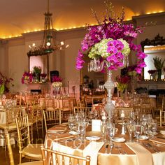 Tall centerpieces of greens and fuchsia orchids made for some dramatic décor.
