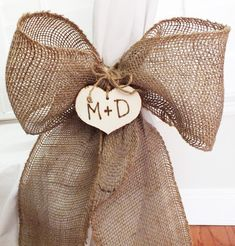 Chair cover idea at reception. Easy DIY. Burlap Bow Or Burlap Pew Bow A Rustic Wedding Or Vineyard Wedding Decoration.