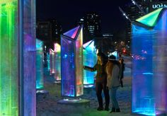 Amidst a winter snowscape, a public plaza in downtown Montreal is glimmering like a jewel thanks to a public art installation comprised of kaleidoscopic prisms.
