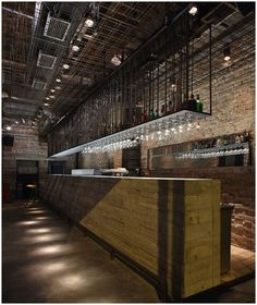 Glass racks, tall ceiling, lighting, mood, bar, exposed brick - KB
