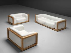 For Sale on 1stdibs - Carlo Scarpa for Simon, 'Cornaro' sofa and lounge chairs, white fabric, ash wood, Italy, 1973 The sofa and loveseats have a very thick cushion and are