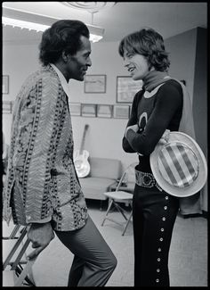 12/6/69, CA — Mick Jagger of the Rolling Stones with Rock 'n' Roll legend Chuck Berry, backstage at earlier shows through the South on the Let It Bleed tour, where Chuck Berry (Keith Richards' hero) was their supporting act.– Photograph © Ethan Russell. All rights reserved.