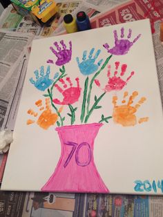 Handprint flowers in a vase on a canvas. Perfect for Mother's Day or a birthday present :)