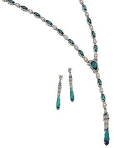 TOURMALINE AND DIAMOND SAUTOIR AND PAIR OF EAR PENDANTS Comprising: a sautoir designed as a series of millegrain-set foliate motifs embellished with variously-shaped tourmalines, to a facetted briolette drop, set throughout with circular-, single- and rose-cut diamonds, length approximately 750mm, pendant length approximately 120mm, together with a pair of earrings en suite, post and butterfly fittings.