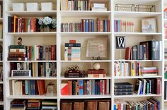 Ikea Billy bookcases backed with burlap...I want bookshelves everywhere in my home!!!
