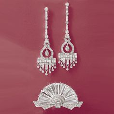 Relive all the glamour and glee of the roaring twenties with our deco-style CZs. So fabulous and jazzy, even Daisy Buchanan wouldn't have known they're faux. >>Click on the CZ linear chandelier earrings & Art Deco-style CZ fan pin for more details.