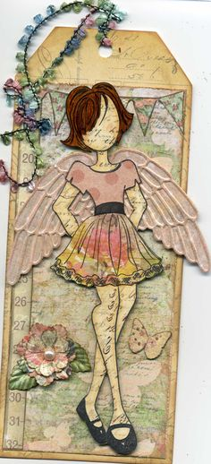 My favorite of the 2nd round of Julie Nutting Mixed Media doll stamps.  Used my Cuttlebug Vintage Collage folder for the wings, and although you can't see it, glittered them with the Wink of Stella glitter pen in clear.