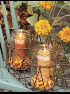 Centerpieces with candy corn.... could also use the candy corn pumpkins