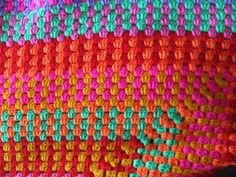 granny square.  Love her choice of colors.  Made an ordinary pattern unique.