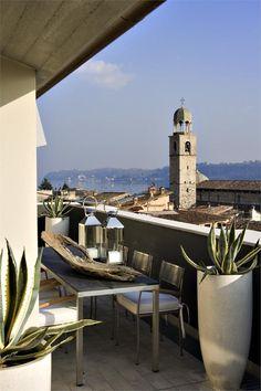 BAGLIORI SULL'ACQUA - Un attico tra i tetti antichi del Lago di Garda - Salò, Italy by Claudia Pellizzari Interior Design #outdoor #design #architecture #landscape