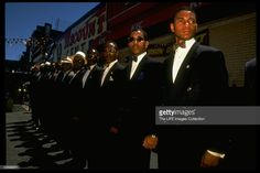 Group of Nation of Islam men standing at attention during rally to close crack house in Brooklyn.