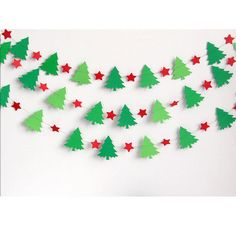 Christmas Tree Garland is the perfect festive addition for your holiday party. Dress up your mantle, window, stairs, door or hang from the ceiling