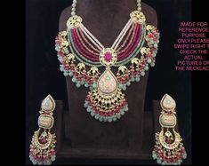 VeroniQ Trends- Replica Sabyasachi Designer Kundan/Polki Necklace Set in Multilayer Kundan & Faux Handmade item. Material: Brass, Glass, Gold, Silver, Stone Kundan is a traditional form of Indiangemstone jewellery involving a gem set with a gold foil Kundan Jewellery Set, Fancy Jewellery, Stylish Jewelry, Unique Jewelry, Silver Jewelry, Diamond Jewelry, Rajput Jewellery, Etsy Jewelry, Fashion Jewelry