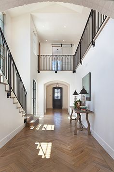Transitional French Entry design with a touch of country French with the barn doors upstairs and the simple metal railing design. Informations About Transitional French Interior Design Pin You can eas French Interior Design, Luxury Interior Design, French Interiors, Pastel Interior, Classic Interior, Casa Milano, Staircase Railings, Metal Railings, Staircases
